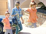 Mommy's little fashionista! Jessica Alba's mini-me daughter Haven, two, proudly parades her shell-covered handbag during outing with her mother