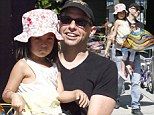 Family man: Jon Cryer got his daughter Daisy a colourful balloon on Sunday during a family trip to a Los Angeles farmer's market