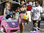 She's coming up roses! Pink shows off her slender figure in feminine floral as her daughter Willow whizzes around in a toy car