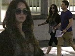 Under wraps: Pregnant Megan Fox dons sunglasses and keeps baby bump hidden for casual dinner with Brian Austin Green