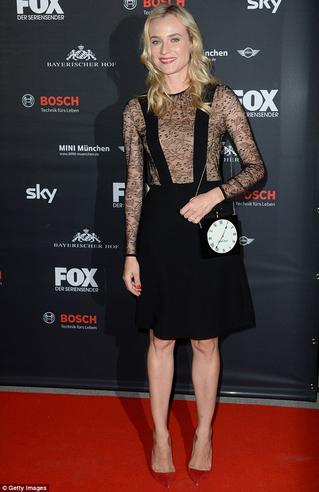 Dressed to impress: Diane Kruger stuns in a black frock with sheer lace detailing and a clock bag at Friday night's screening of The Bridge in Munich