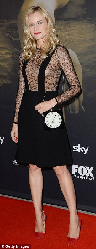 Tick tock: She accessorised with her blonde locks down and wavy, red pointy heels and matching scarlet lipstick
