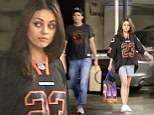 Two of a kind! Die Hard Chicago Bears fans Ashton Kutcher and Mila Kunis show their support for the team in matching tops after watching football together at home