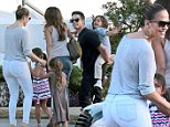 Tightknit group: JLo steps out in ultra-fitted jeans as she goes to dinner with boyfriend Casper and twins Emme and Max