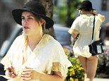 Tallulah Willis shows a little too much skin as her extremely short shirt dress blows up in the wind