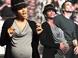 A very pregnant Halle Berry gets her groove on as she dances with her beau Olivier Martinez at Earth, Wind & Fire concert