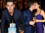 Birthday kiss! Nick Jonas turns 21 as he passionately embraces his Miss Universe girlfriend Olivia Culpo at Sin City bash