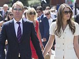 Splitsville? Elizabeth Hurley and Shane Warne, pictured as Ascot on July 27, have sparked speculation they have split