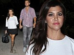 Kourtney Kardashian plays mix and match in monochrome dress and gladiator sandals for dinner out with her family