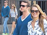 Supermodel Jessica Hart flashes her signature smile and wears mixed print short set while walking her Yorkie with rumored fiance in New York on Sunday