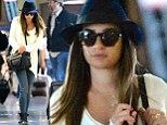 Still healing: Sombre Lea Michele jets back to LA after filming Glee scenes in New York, two months on from tragic death of boyfriend and co-star Cory Monteith