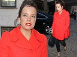 Lily Allen is a retro darling in bright red coat and black Cigarette pants at Giles Deacon S/S14 show