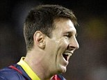 All smiles: Messi celebrates his opener with defener Dani Alves