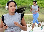 Angela Simmons shows fine form in blue and grey workout gear during beach side run in Miami