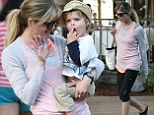 Don't leave her hanging! Selma Blair gets ready for a high five with son Arthur