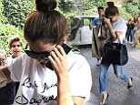 Enjoying her time off! Selena Gomez goes on a Versace shopping spree after her Russian tour dates get cancelled