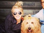 Spot the difference: Julianne Hough and her friend's dog sported matching blonde top knots earlier this week
