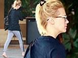 Just woken up? January Jones has a bad hair day in LA... as rumoured ex-lover Liam Hemsworth is seen kissing Eiza Gonzalez
