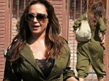 You're definitely not being all you can be! Leah Remini has a fashion fail in an unflattering army-green jumpsuit at Dancing With The Stars rehearsals