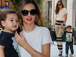 Miranda Kerr stuns in electric blue pumps as she takes son Flynn out... just hours after painting the town red with husband Orlando Bloom