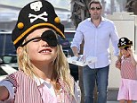 Anything for donuts! Ben Affleck's daughter Violet dresses like a pirate to score a freebie... with a little help from her dad