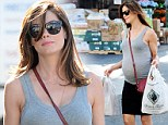 Not long to go! Heavily pregnant Michelle Monaghan displays her growing bump in clingy top and skirt during grocery run