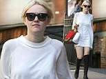 Dakota Fanning lets her feet do the talking as she steps out in a pair of knee high leather boots teamed with a short sweater dress