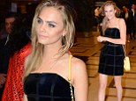 When in Milan... Cara Delevingne trades in her usual jeans and trainers for a sophisticated strapless LBD