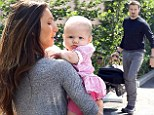 Playing happy families: Jeremy Renner and ex-girlfriend Sonni Pacheco enjoy an amicable outing with precious daughter Ava