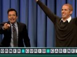 Second chance: Jimmy Fallon and Paul Atkinson celebrate as the Wheel of Fortune contestant says his phrase correctly