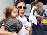Mummy's little punk princess! Harper Beckham rocks a pair of Dr Marten boots and purple jeans for day out with Victoria