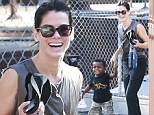 Sandra Bullock enjoys a giggly outing in LA with comedian Michael McDonald before reuniting with her equally happy son Louis