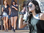 Two of a kind: Kylie Jenner and pal Sofia Richie go shopping hand-in-hand in twin T-shirts and cuff-off shorts