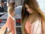 Looking just peachy: Vanessa Hudgens heads to a meeting in a stunning colour block dress
