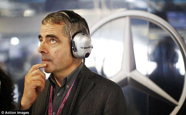 Star turn: Rowan Atkinson was in the Mercedes garage for qualifying