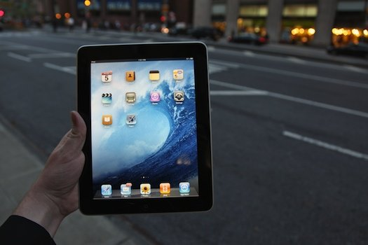 holding an ipad in the street