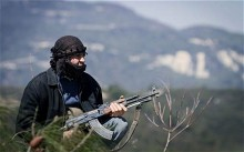 A member of the Free Syrian Army in the mountains west of Idlib, March 2012