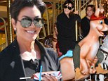 Kris Jenner chomps on corn dogs and rides a kangaroo on a carousel with new best pal... daughter Kim's BFF Jonathan