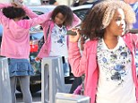 Not exactly a Hard Knock Life! Quvenzhané Wallis jokes around with the crew and works on her dance moves on Annie set