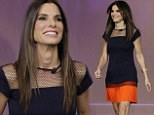 Orange is the new black! Sandra Bullock wears Halloween colors to reveal she never dated George Clooney on the Tonight Show