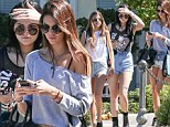 Triple threat: Kendall and Kylie Jenner enjoy a shopping trip with BFF Sofia Richie in matching denim cut-offs