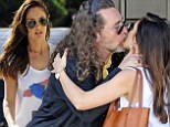 She's a daddy's girl at heart! Minka Kelly gives her rock star father Rick Dufay a loving kiss after lunching in Los Angeles