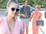 The look of love! Kaley Cuoco and fiance Ryan Sweeting stroll hand-in-hand as she flashes giant engagement ring