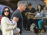 Just call them The Glums! Alec and Hilaria Baldwin appear downcast on stroll out with baby daughter Carmen