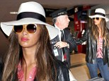 The personal touch! Nicole Scherzinger gets a helping hand from an airport porter as she arrives in Toronto