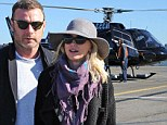 Flying high! Liev Schreiber whisks Naomi Watts away in a helicopter for romantic trip to celebrate her 45th birthday