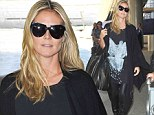 Ready to take flight! Heidi Klum sports a top emblazoned with a rising phoenix as she arrives at LAX after trip to Germany