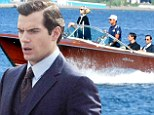 Life is but a dream! Dapper Henry Cavill cruises around Italy in a boat for new Guy Ritchie movie The Man From U.N.C.L.E.