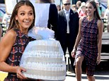 Anyone for diapers? Jessica Alba turns sexy saleswoman as she turns up on the set of Extra armed with her wares