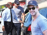 Liam Hemsworth is 'over the Miley drama' as he arrives in Atlanta... as Cyrus 'pulls out all the stops' to get his attention